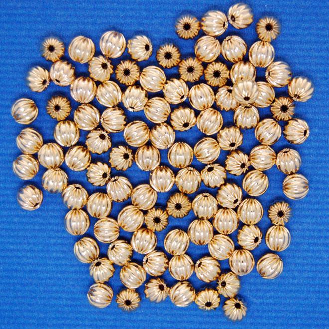 Corrugated Bead | gilt base metal